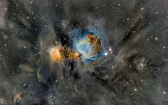 The Orion Nebula, is inundated with intricate and picturesque filaments of dust. Opaque to visible light, dust is created in the outer atmosphere of massive cool stars and expelled by a strong outer wind of particles. The Trapezium and other forming star clusters are embedded in the nebula. The intricate filaments of dust surrounding M42 and M43 appear grey in the above image, while central glowing gas is highlighted in brown and blue.