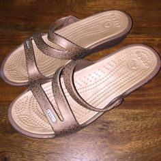5f6ea8480c29 Shop Women s crocs Tan size 7 Sandals at a discounted price at Poshmark.  Description  CUTE TAN SANDALS WITH A PATTERN! Crocs are awesome.