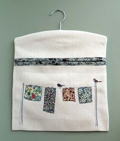 This pretty peg bag makes hanging out the washing a pleasure! Ok… perhaps that's taking it a bit far, but if a job needs to be done, why not do it in style? The gorgeous liberty print fabric that adorns the washing line has been machine embroidered on. Fabric Crafts, Sewing Crafts, Sewing Projects, Pretty Pegs, Clothespin Bag, Peg Bag, Fabric Pictures, Sewing Aprons, Wooden Hangers