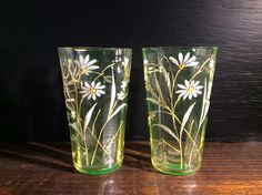"""SOLD. Pair of striking Uranium Glass beakers. Flared form with nine soft facets internally to encourage refraction (see info card). Hand-finished externally with frosted and gold flora.  Excellent order. 4"""" high.  B.G. 6102                    £65"""