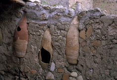 Pompeii / Wall with amphoras / (Roman city; buried during Vesuvius eruption in 79 A.D.; excavations started in 1748). Amphoras which were mortared into the wall of a house in Insula 9.