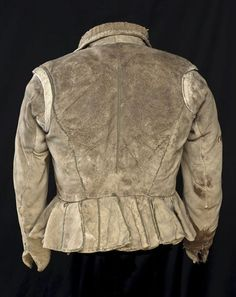 The back of the doublet who once belonged to Hugo de Groot, made in buff leather - I think it's about 1610-1620.