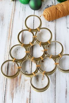 Mason Jar Lid Wreath crafts, a tutorial on how to create a Christmas lid Wreath in any size, Mason jar craft tutorial using canning lids to shape a tree Jar Lid Crafts, Mason Jar Crafts, Ring Crafts, Wreath Crafts, Hanger Crafts, Wreath Ideas, Christmas Projects, Christmas Wreaths, Christmas Ideas
