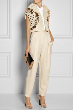 DELPOZO jacket, Acne top, Chloé ring and clutch, The Row pants, Givenchy shoes. V
