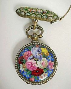 BOUVET FLEURIER market watch (or La Montre Chinoise) with floral enameled case surrounded by seed pearls, circa suspended from a mosaic bar brooch. Antique Watches, Antique Clocks, Vintage Watches, Vintage Clocks, Antique Jewelry, Vintage Jewelry, Unusual Jewelry, Vintage Accessories, Jewelry Accessories