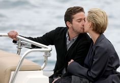 """Shia LaBeouf Photos - Shia LaBeouf and Carey Mulligan share a few tender moments and a kiss while waiting in a boat to be taken to a press junket at Eden Roc for their film, """"Wall Street Money Never Sleeps. - Carey Mulligan and Shia LaBeouf in Cannes 2 Shia Lebouf, Carey Mulligan, Never Sleep, Cannes, In This Moment, Film, Wall Street, Waiting, Boat"""