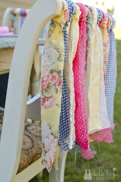 Brightly colored fabric tied to the back of a chair is a fun and easy way to decorate for a party or Easter Brunch.  So cute for a child's party.  Great way to use up pretty fabric scraps.  Cottage and shabby