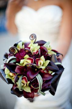 Burgundy Calla lilies, Green Cymbidium orchids, Monkey tails, burgundy Dahlias.  I would not mind at all if someone were to send me this in an arrangement someday.