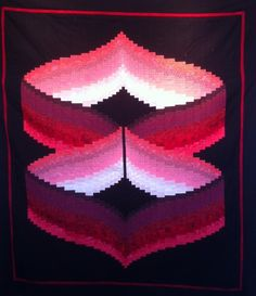 "Quilt Inspiration: Twist-and-turn Bargellos: Infinity Bargello, 50 x 57"", by Eileen Wright as seen at Texas Quilt Works"