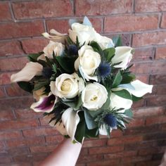 vermeer calla lily, avalanche rose and thistle bouquet, finished with touches of hard ruscus.