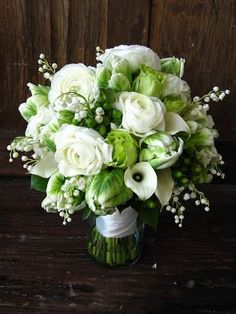 Perfect green and white bouquet with Mini Calla Lilies, Hypericum, Lily of the Valley, Ranunculus, Roses, and Tulips.
