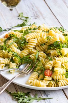 A Lemon Rocket Pasta Salad full of freshness and green goodness. The large fusilli pasta is tossed in fresh lemon juice and just a little olive oil to create this bright, vibrant salad, perfect for a cold lunch on a hot day!