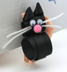 Black cat grosgrain ribbon with googly eyes hairclip by edieandme, $5.00