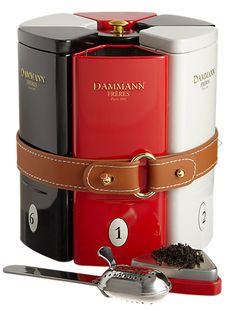 Dammann Frères [Dammann Freres]  Multiboite Symphonie Gourmet Tea Sampler and Infuser  ... six red, white or  black individually numbered tea tins, belted together in a cylinder shape with stainless steel infuser in the centre, 2015, France