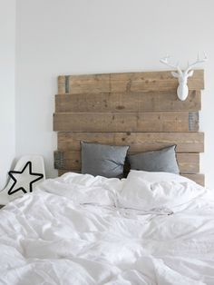 wooden headboard - but would make it white and put a letter instead of deer
