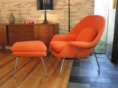 Fascinating Mid Century Modern Chairs Make Your Elegant Living Room Furniture Decor: Fabulous Orange Mid Century Modern Chair With Lounge Design And Modern Stainless Legs On Wood Flooring Completed With Grey Carpet Home Flooring Creative Furniture Designs