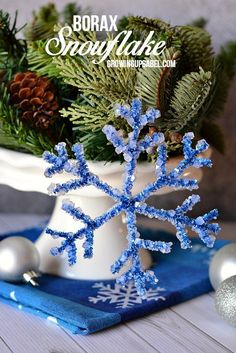 Gather the kids, some Borax and pipe cleaners to make these adorable snowflake crafts for kids! Hang on the Christmas tree or just keep around all winter long.