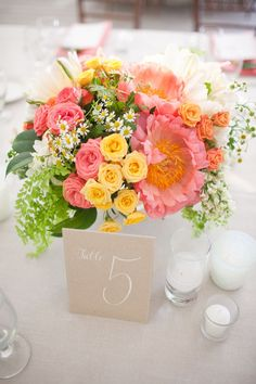 Bright, peppy #centerpiece florals + #tablenumber   Photography: http://anniemcelwain.com   Planning: http://greenribbonparties.com   Floral Design: http://brownpaperdesign.com