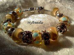 Schickes Original Pandora* Armband, 925 Silber ALE mit 16 Elementen von Elemento und Larenza.   Die Beads sind keine Original Pandora* Elemente, sonde