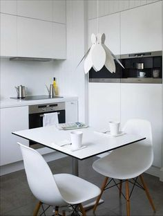 A tiny white kitchen.