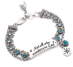"An amazing Engraved Bar Bracelet with the quote ""Not all who wander are lost"". This lovely adjustable bar bracelet is created in durable, tarnish free solid 316L stainless steel, Swarovski crystals® in shades of blue, and a beautiful compass charm. Your ID bracelet can been worn daily and is completely water proof, and because it is laser engraved the letters will always remain black. the bracelet including the chains is only 3/4"" wide."