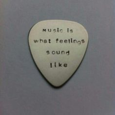 Music is what feelings sound like - hand stamped plectrum. This metal plectrum is perfect for the guitar lover or musician. You will receive one plectrum hand stamped 'music is what feelings sound…MoreMore Tattoo Musik, Guitar Tattoo, Hand Gestempelt, Les Sentiments, Music Tattoos, Guitar Picks, Music Lyrics, Playlist Music, Music Music