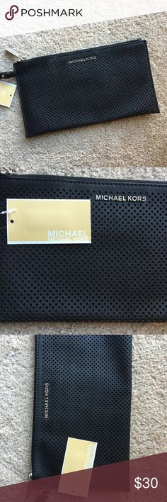 Michael Kors Black Travel Wristlet Zip Clutch Bag A small black wristlet bag by Michael Kors in black perforated leather, lined with an inside pocket and inner card pockets. Zips closed on top. Brand new with tags and perfect! MICHAEL Michael Kors Bags Clutches & Wristlets