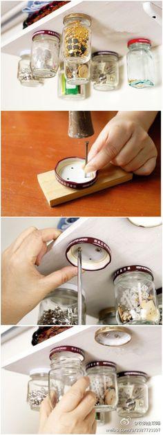 Hang mason jars under a shelf by screwing the lid under the shelf