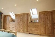 Innovative bedroom design - wardrobes built into the sloped ceiling | Bedrooms and Bathrooms ...