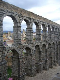 This is part of the Roman Empire remains found in Segovia, Spain. This is an ancient aqueduct that has stood its ground for hundreds of years. This aqueduct is still used today! Spain And Portugal, Ancient Ruins, Roman Architecture, Ancient Architecture, Beautiful Architecture, Places Ive Been, Places To Go, Places To Travel, Travel Destinations