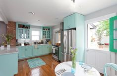 I love some of the elements of the kitchens on here... I have always been a sucker for midcentury modern style. I love this kitchen's blue cabinets; so happy looking!