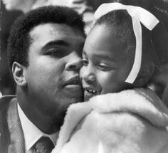 "His only Fresno visit, Muhammad Ali gives 7-year-old Elicia Pace a hug. The occasion was a May 20, 1971 benefit boxing show at Selland Arena; planned beneficiaries were the family of Eddie Pace, a boxer from Los Angeles who died a few months earlier. Only 257 fans showed up, so the promoter and the beneficiaries lost out. Ali didn't let the Paces go home emptyhanded – he reportedly gave Elicia $500 and told her, ""This is for you. Give it to your mommy & buy something nice."" Ryan Marty Fresno…"