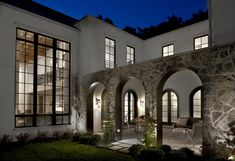 Searl Lamaster Howe Architects - Asbury Residence: View through arched openings into central courtyard