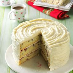 White Chocolate Christmas Torte Recipe -Talk about a scene-stealer! This raspberry-filled cake, an exceptional dessert for any meal, is an especially lovely ending for a holiday feast. —Carol Gillespie, Chambersburg, Pennsylvania