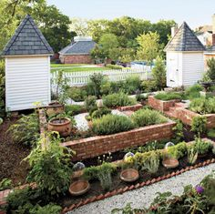 potager vegetable garden-love these brick raised beds and the beautiful garden cloches (bell jars).
