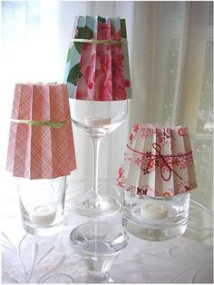 I am definitely trying this. Looks like 4 cheap & easy items to obtain: 1. wine glass or tumbler and 2. flameless tea candles from a dollar store, 3. pretty paper/origami paper, 4. ribbon from Michaels.