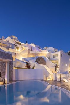 Santorini, white houses and pools