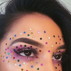 Covered in stars ✨✨✨ tried something new and a little arty BROWS @anastasiabeverlyhills #dipbrowpomade in #darkbrown LASHES @flutterlashesinc EYES @urbandecay solstice