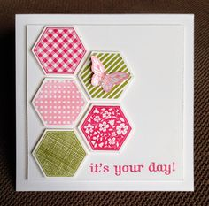 hexagons in pinks and greens, topped with butterfly