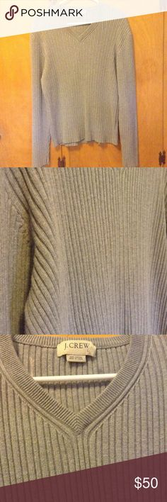 J. Crew Men's V-Neck Sweater Size L Men's J. Crew Ribbed V-Neck Sweater  Gray  Size large  Long Sleeve 100% Cotton   Pre-owned; in good used condition.  There is some discoloration on the inner back shoulder area that does not go through to the outer back area. Flaw is unseen from the outside.   Rated 4/5 J. Crew Sweaters V-Neck