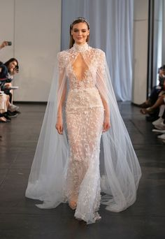 Brides want to find themselves having the most appropriate wedding, but for this they require the perfect wedding dress, with the bridesmaid's dresses actually complimenting the brides-to-be dress. These are a number of ideas on wedding dresses. Floral Wedding Gown, Hijab Wedding Dresses, Wedding Cape, Ceremony Dresses, Bridal Cape, Wedding Dress Trends, Bridal Dresses, Bridesmaid Dresses, Wedding Dresses With Cape