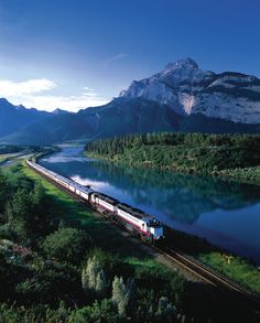 The Rocky Mountaineer is a luxury train that has all the trimmings of its overseas counterparts. In the wild and remote Rocky Mountains of Western Canada, this train will take you past some of North America's best scenery. Rocky Mountains, Dream Vacations, Vacation Spots, Train Vacations, Vacation Packages, Places To Travel, Places To See, Travel Destinations, Places Around The World