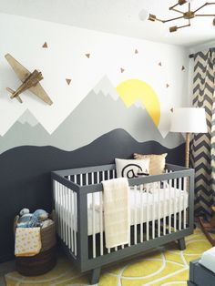 Our nursery! Crib by babyletto, fixture from Schoolhouse electric, curtains from West Elm. View more on leclairdecor.com #nursery #modernnursery #schoolhouse #westelm