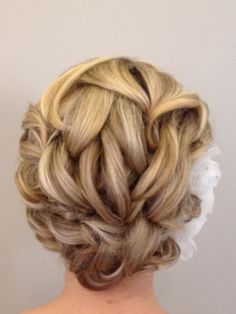 Beautiful updo created by Megan Lelonek, of Five Star salon and Spa, polished smooth using Oribe's Soft Lacquer.