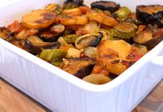 Briam - Roasted aubergine (eggplant), courgette (zucchini), onion, potatoes and tomatoes. A simple dish of the above vegetable sliced and baked with garlic and, of course, Extra Virgin Olive Oil :). This dish is generally made in the summer and is another example of simple Greek vegetable made into a very tasty meal. Suitable for vegetarians.