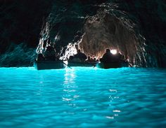 Blue Lagoon, Capri, Italy. You can only enter when the tide is at a certain level, but an amazing experience. The water is actually that blue and you have a man singing opera to you as he paddles you around!