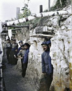 French Artillery soldiers are shown at the entrance of their shelter on the Western Front.  Rare WWI color photograph made with an  Autochrome Lumière technique.