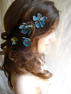 This girl has got some amazing flower hair pins in her etsy shop.