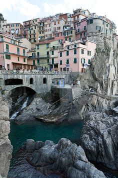 """The Cinque Terre. Translated, literally, """"The Five Lands"""" – villages built into the cliff sides of the northern coast of Italy – the Italian Riviera, if you will. And Liguria is home to many places beautiful like the Cinque Terre . Places Around The World, Oh The Places You'll Go, Places To Travel, Places To Visit, Dream Vacations, Vacation Spots, Cinque Terre Italia, Malta, Wonderful Places"""