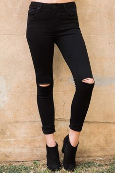 Off She Goes, looking like supermodel, in these fine Black Skinny Jeans! Girl, you need to look into an agency! These skinny jeans feature standard 5 pocket styling, belt loops, a zipper button fly, and rips at the knees.   • 75% Cotton, 23% Polyester, 2% Spandex  • Machine Wash Cold • Unlined • Made in the USA